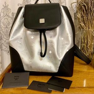 MCM Claudia Metallic canvas and leather backpack